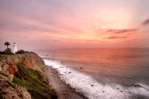 The sun sets as Point Vicente Lighthouse illuminates its light on the most southwesterly point of the Palos Verdes Peninsula in Rancho Palos Verde on Wednesday. //ADDITIONAL INFORMATION: trav.palosverdes.xxxx– 02/18/15 – ED CRISOSTOMO, ORANGE COUNTY REGISTER- Wayfarer's Chapel and Point Vicente Lighthouse. This is one of my favorite day trip getaways, and it's really close, though it feels really far. The Point Vicente Lighthouse is adjacent to the Point Vicente Interpretive Center in Rancho Palos Verdes and maintained by the U.S. Coast Guard. It was built in 1926 and decommissioned in 1975. Tours are available on the second Saturday of each month. The City acquired this property from Los Angeles County through a grant deed in May 2004. This 10.5-acre site features a paved parking lot, a restroom building, an improved trail to the shoreline, and incredible Catalina and ocean views. You don't have to be religious to appreciate the architectural beauty of the Wayfarers Chapel, which was designed by Lloyd Wright, Frank Lloyd Wright's son.