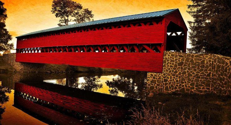 sunrise-reflections-over-covered-bridge-dave-sandt
